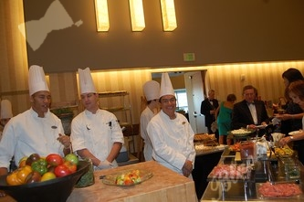 Chefs waiting to serve up appetizers from one of the many creative food stations during the reception
