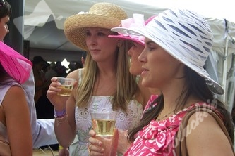 Great looking Derby girls enjoying champagne and wine