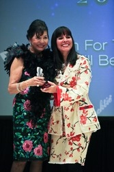 Bea Khan Wilhite, left, presents the Retailer category award to Mona Lucero of Mona Lucero.