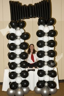 This larger than life balloon display shaped like a Blacktie was provided by Full Blown Events owner, Debra Griffin -- There she is in the middle of the display!