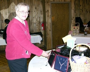 Arlene Hubbard at the silent auction table