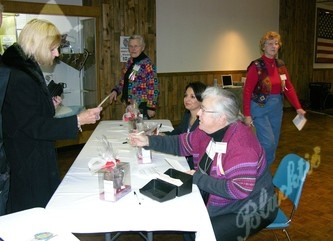 Volunteer Paulene Janes (right) assist with check in