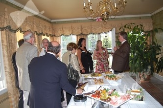 Guests indulging in the great appetizer buffet provided by Three Tomatoes