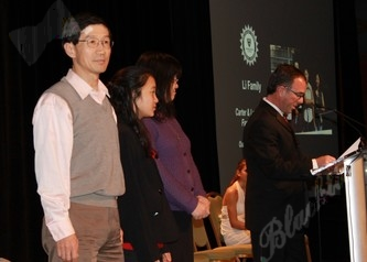 The Li family accepts the award for utstanding service to the tennis community