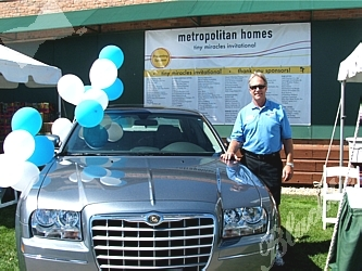 Bruce Mardick of John Elway Chrysler /Jeep raised thousands of dollars by raffling a 300 Touring Sedan