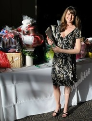 Amanda Bleck looks through some auction items