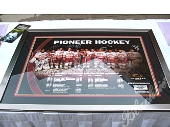 Just one of the fabulous silent auction items, an autographed poster of the Pioneer Hockey team