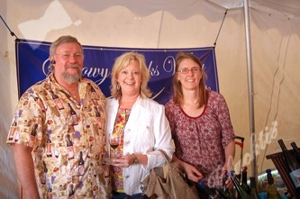 FMHP board member Katie Wilkins (center) enjoys some wine with Lyman Wilkinson and Candace Mohr, owner/manager of Snowy Peaks Winery