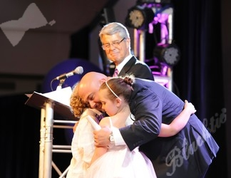 Man of the Year Marc Paolicelli hugs Taylor and Jack