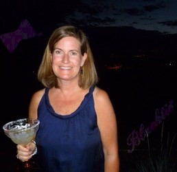 Jennifer Nicholas enjoys the lights of Denver from the patio.