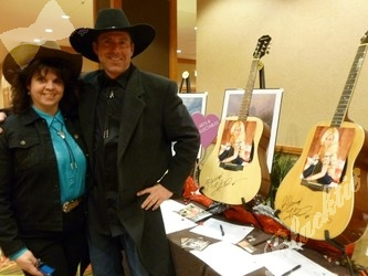 Christina Cashion and Mark Reynolds check out guitars autographed by Kellie Pickler