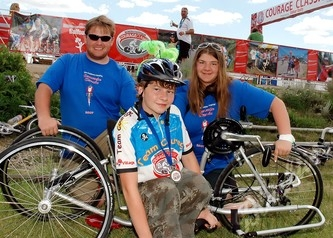 Dominic Harden, a 2006 Children's Hospital Ambassador (front) with his brother Paul and sister Cecilia