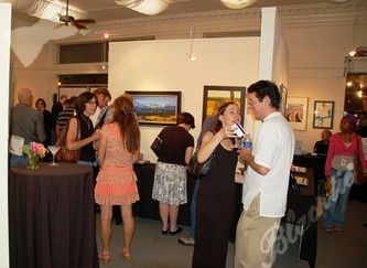 As the silent auction winds down, guests take a final look at the art.