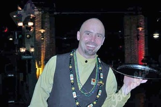 Doug McCorkle with Catering by Design desked out in Mardi Gras beads.
