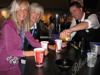 Linda Schierburg (left) and Jane Anhold enjoy soft drinks poured by Joe Dawley