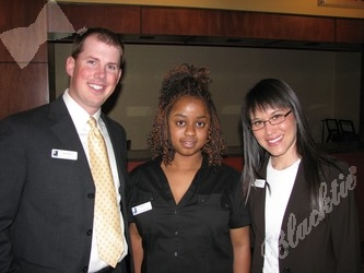Brady Grant, left, takes time for a photograph with Deidra Ward and Nona Urban.