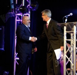 Marc Paolicelli, left, accepting his award for 2012 Man of the Year from Ed Greene
