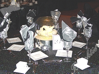 Previous Photo Metallic silver and black linens complemented table settings and the event\u0027s starlit theme. & Blacktie | Photos | Metallic silver and black linens complemented ...