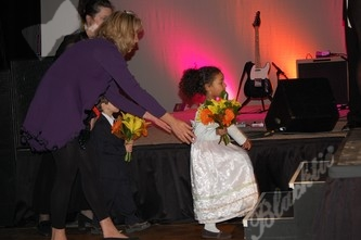 LIttle Samaiah gets ready to present flowers on stage