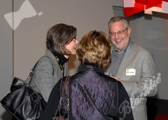 Sharon Kermeit (left) and Ric Berninzoni enjoy the party and network with other guests