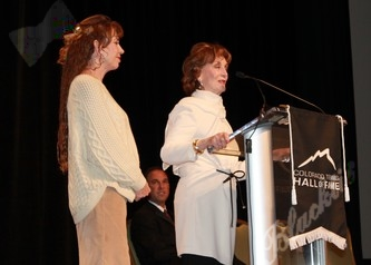 Mirian and Betsy Benham accept Clayton Benham's induction in to the Hall of Fame