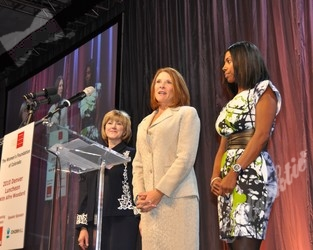 Co-chairs Cathy Hart (l), Susan McIntire and Piper Billups on stage to share their appreciation to all of the sponsors