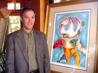 Marc LeVarn of Vail Fine Art with one of three pieces the gallery is donating to the Childrens Hospital Gala auction. This print is by Alexandra Nechita, the 13-year-old wunderkind dubbed the