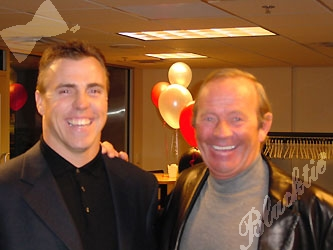 Bill Romanowski, left, with an unusually tall Pat Bowlen