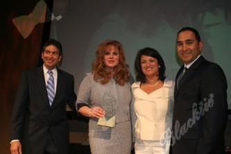 Chairman of the Board Luis Colon, Corporate Advocate of the Year recipient Perla Gheiler, Business Woman of the Year recipient Ivette Dominguez and President and CEO of the DHCC Jeffery Campos
