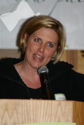 Emcee April Zesbaugh, co-host  of 850 KOA's Colorado's Morning News, kept the luncheon's agenda lively and well-paced