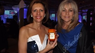 Kempe President & CEO - Patricia Peterson with Lark Katchur (committee member) display the beautiful three-stone diamond ring that was a live auction item.