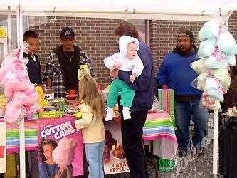 Cotton candy, barbecue, snow cones and other goodies enticed kiddies and adults alike.