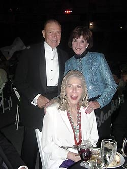 Phylis Coors and her date, former U.S. Defense Secretary Robert McNamara, and Dawn Denzer (seated)