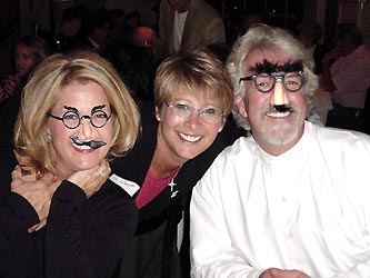 Groucho wannabes Shery McDonald Galbreath, left, dinner co-chair Jill DiPasquale, and Gary Paul